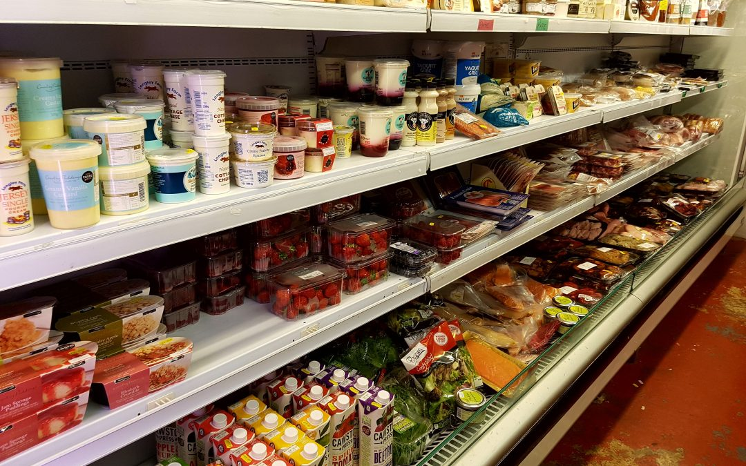 Carpenters Farm Shop Banbury - Shelves full of dairy produce, fresh fruit, salad, milk, juice and smaller packs of meat